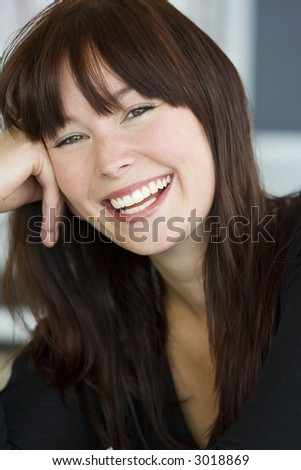A beautiful green eyed young woman relaxed and laughing