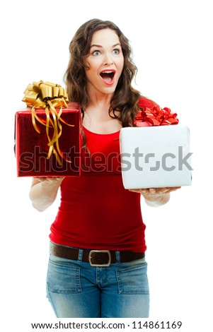 A beautiful happy and surprised  woman holding two beautifully wrapped Christmas gifts. Isolated on white.
