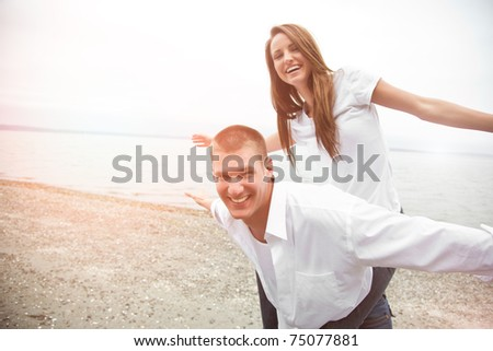 A beautiful happy caucasian couple in love on the beach
