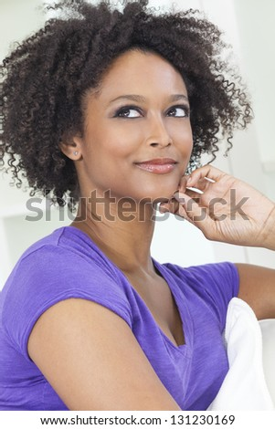 A beautiful happy mixed race African American girl or young woman - stock photo