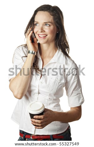 A beautiful happy woman talking on her cell phone and holding a take away coffee. Isolated over white. - stock photo