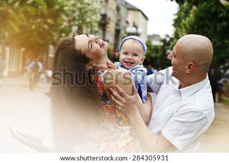 a Beautiful happy young family with baby - stock photo