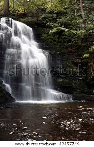 A beautiful hidden waterfall in the forest. - stock photo