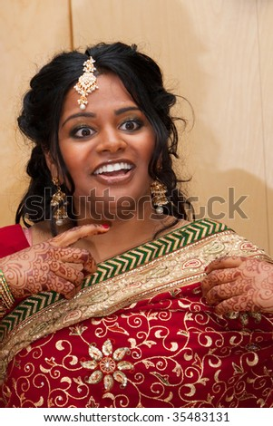 A beautiful hindu bride prepares for her wedding day - stock photo