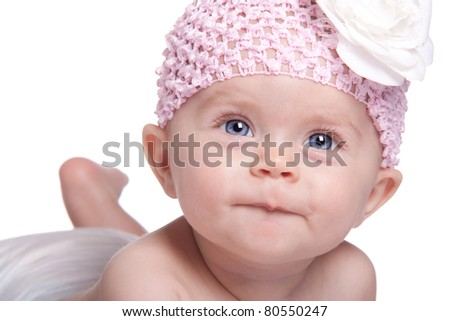 A beautiful image of a peaceful, happy and serene baby girl.  She has a look of excitement, curiosity and happiness on her face.  She represent pure joy.  This image is isolated on white. - stock photo