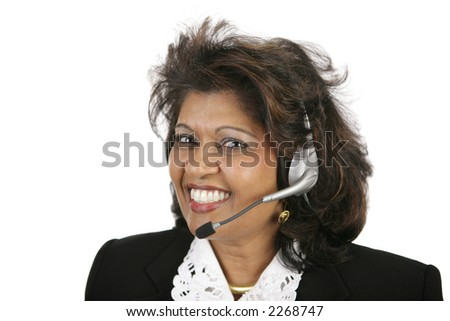 A beautiful Indian customer service agent with a telephone headset.  Isolated on white. - stock photo