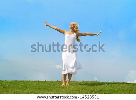 A beautiful lady enjoying the sunny weather in the middle of a field