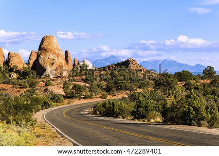 A beautiful landscape view on road with canyons in Arches National Park, Utah, USA