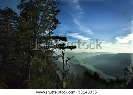a beautiful landscape with a river on the background - stock photo