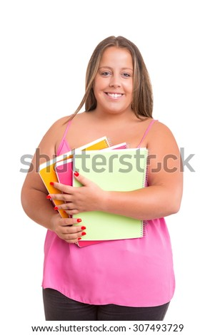A beautiful large student woman, posing isolated over white background - stock photo