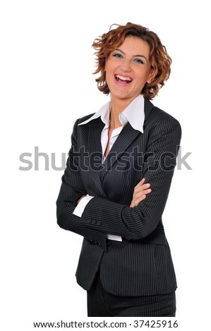 A beautiful laughing business woman wearing a suit, with her arms crossed