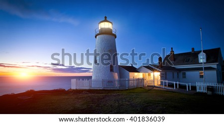A beautiful lighthouse overlooking the ocean  - stock photo