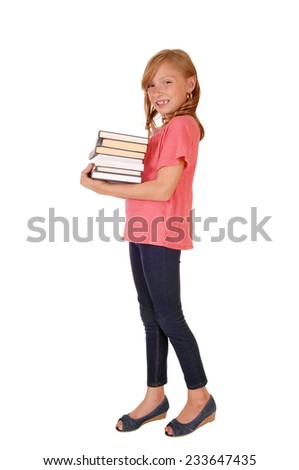 A beautiful little girl in a pink sweater and blond curly hair caring her books, isolated for white background.  - stock photo