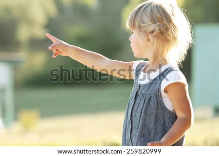 a beautiful little girl on the nature - stock photo