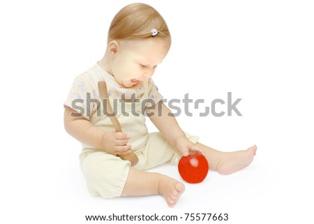 a beautiful little girl with an apple