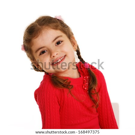 A beautiful little girl with sweet smile - stock photo