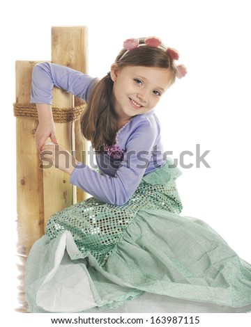 A beautiful little mermaid relaxing by pilings with a watery reflection.  On a white background. - stock photo