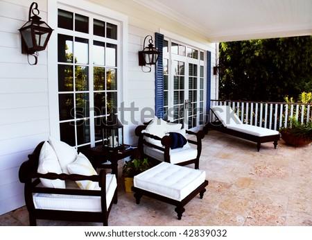 A beautiful lounge area in a new luxury backyard - stock photo