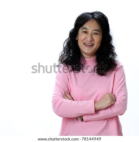 A Beautiful Mature Asian Lady Laughs Joyfully - stock photo