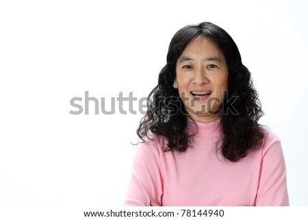 A Beautiful Mature Asian Lady Laughs Joyfully in Surprise - stock photo