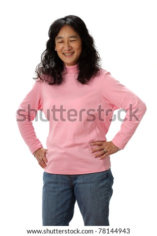 A Beautiful Mature Asian Lady Laughs Joyfully with her Eyes Closed - stock photo