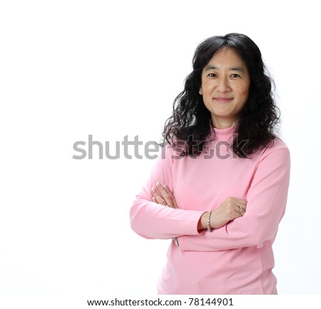 A Beautiful Mature Asian Lady Smiles Confidently - stock photo