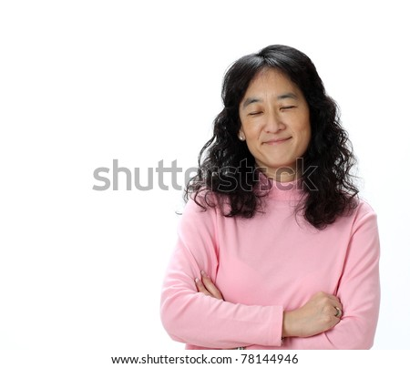 A Beautiful Mature Asian Lady Smirks While Thinking Happy Thoughts With Her Eyes Closed - stock photo