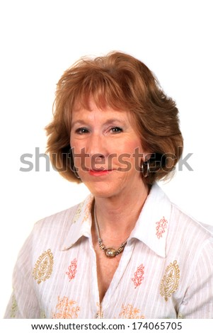 A beautiful mature Caucasian woman smiles for the camera during her fashion photo shoot. The perfect shot for all your Beautiful Mature Female needs. isolated on white with room for your text  - stock photo