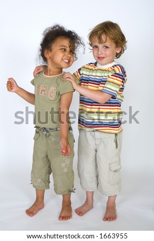 A beautiful mixed race girl and a blonde boy stand together laughing - stock photo