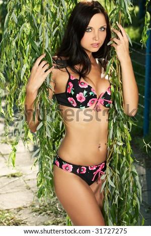 A beautiful model wearing a sexy bikini - stock photo