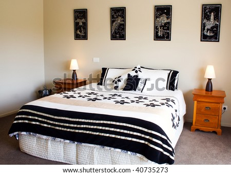 A beautiful modern bedroom interior - stock photo