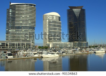 A beautiful morning at the Docklands with boats and yachts on the water in melbourne australia - stock photo