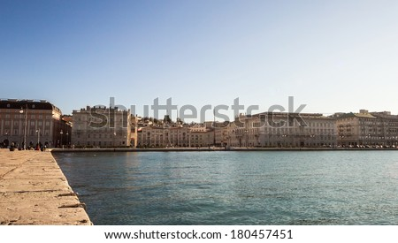 A beautiful morning, with the sun shining on the sea in front of the square of Trieste: Piazza Unit��� d'Italia - stock photo