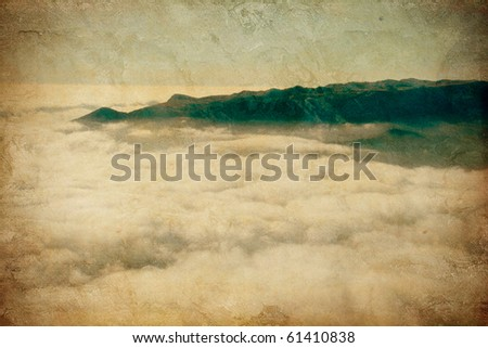 a beautiful mountain landscape on the grunge background - stock photo