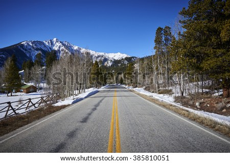 a beautiful mountain road - stock photo