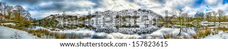 A beautiful 70Mpixel panoramic landscape of Rydal Water in the Lake District on a snowy winters day - stock photo
