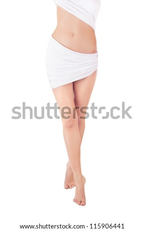 A beautiful naked woman's body covered with blue silk on a white background - stock photo