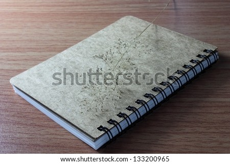 a beautiful note book and wooden background