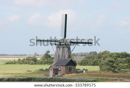 A beautiful old historic windmill, with four wings