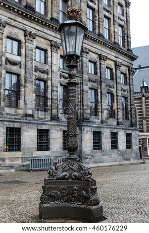 A beautiful old iron lamp post out the front of the Koninklijk Paleis, Amsterdam. - stock photo