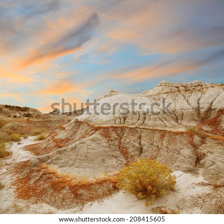 A Beautiful Orange Sunset Over the Northern Unit of Badlands National Park - stock photo