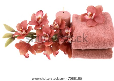 A beautiful orchid, towel and candle - stock photo