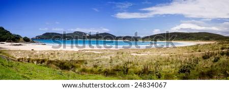 A beautiful panorama of Matai Bay, a popular tourist destination in Doubtless Bay, Northland, New Zealand. - stock photo