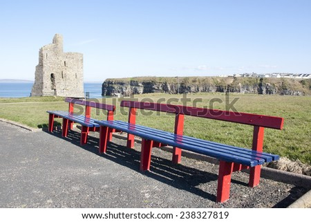 a beautiful path with benches to Ballybunion beach and castle - stock photo