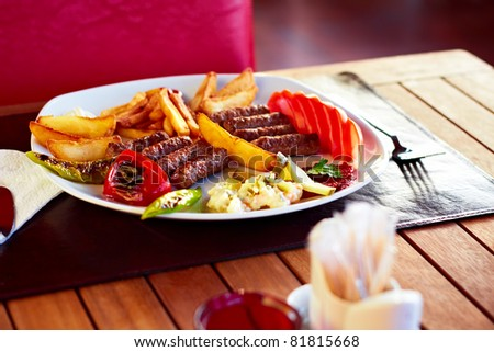 A beautiful plate full of delicious Turkish Kofte (meatballs). - stock photo