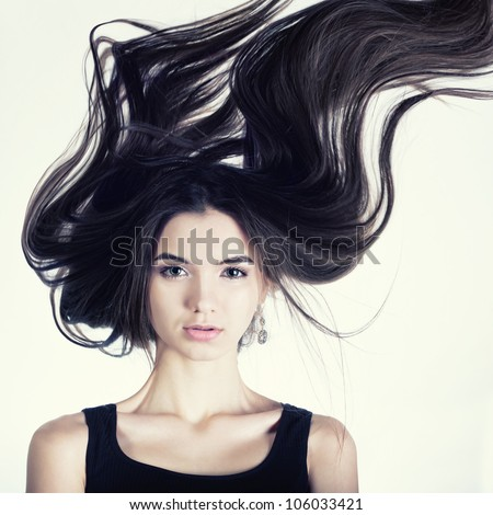A beautiful portrait of a girl with hair emitted - stock photo
