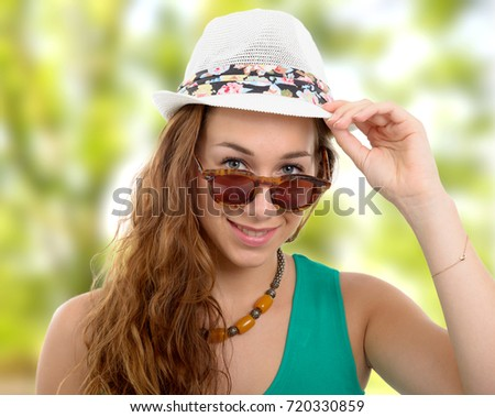 a beautiful portrait of fashion model with hat