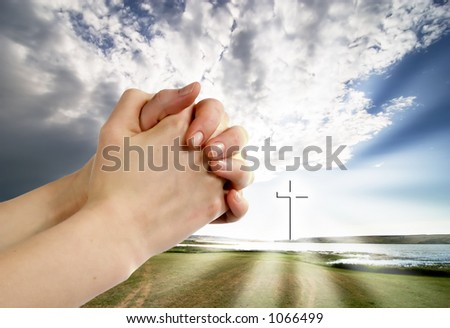 A beautiful prairie lake landscape with a cross.  Life giving water. - stock photo