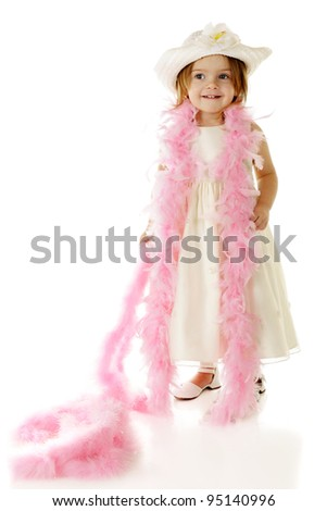 A beautiful preschooler dressed totally in white with a feathery pink boa draped over her shoulders.  On a white background. - stock photo