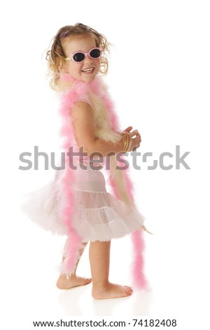 A beautiful preschooler in boas and petticoat, happily shaking her boodie.  Some motion blur on petticoat.  Isolated on white. - stock photo